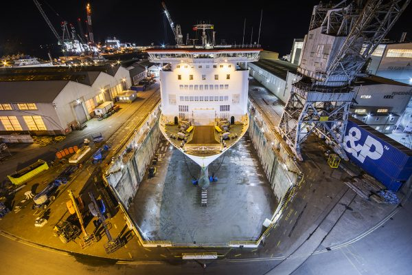Large ship in a dock at night in Falmouth.