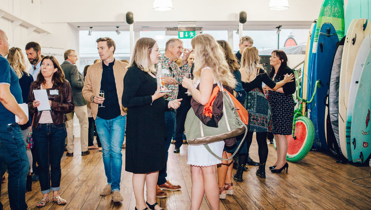 An image of men and women networking at a Cornwall business event