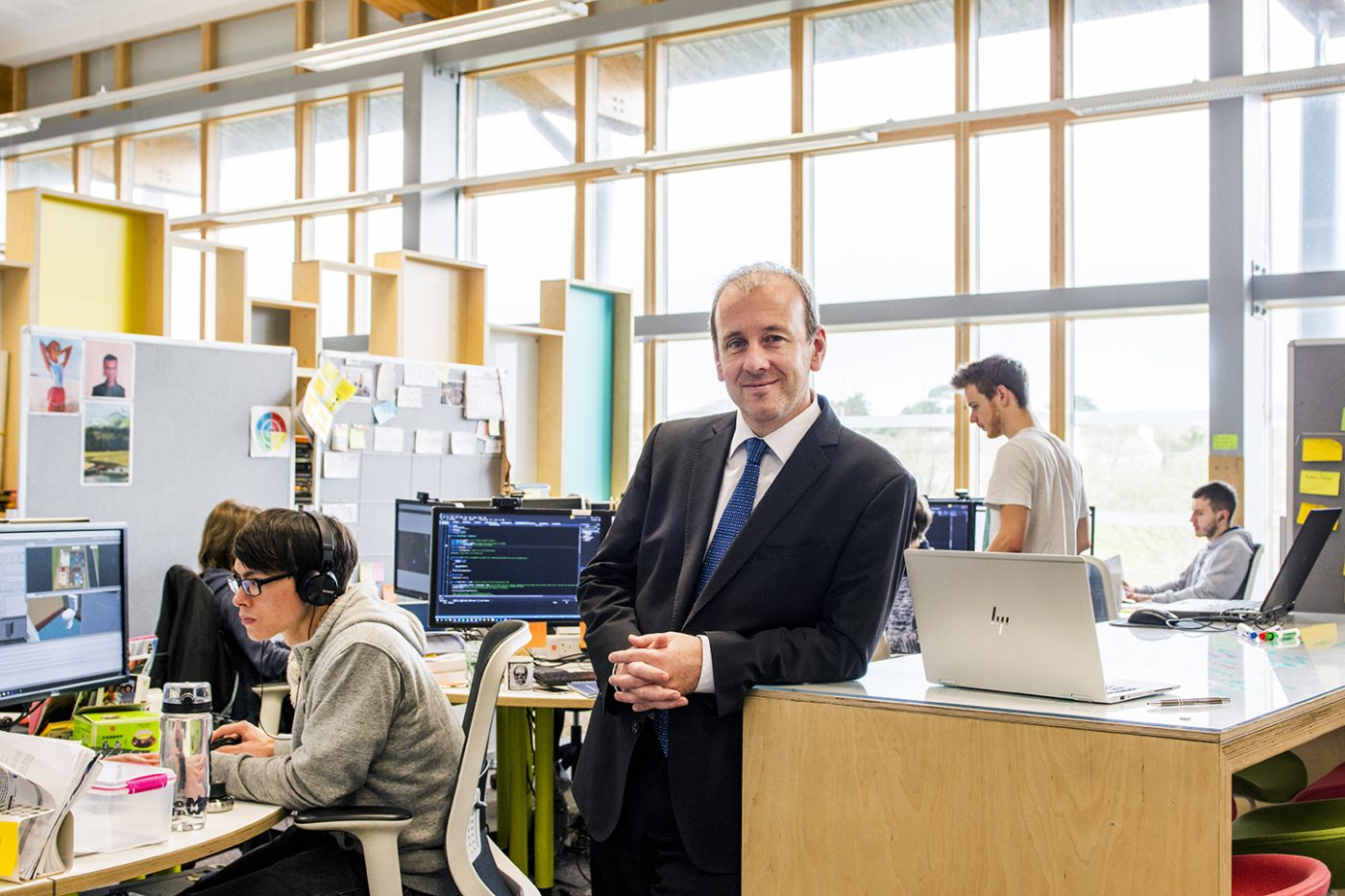 Nick Dixon in a suit at the Radix communications office.