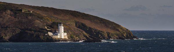 lighthouse stormy sea