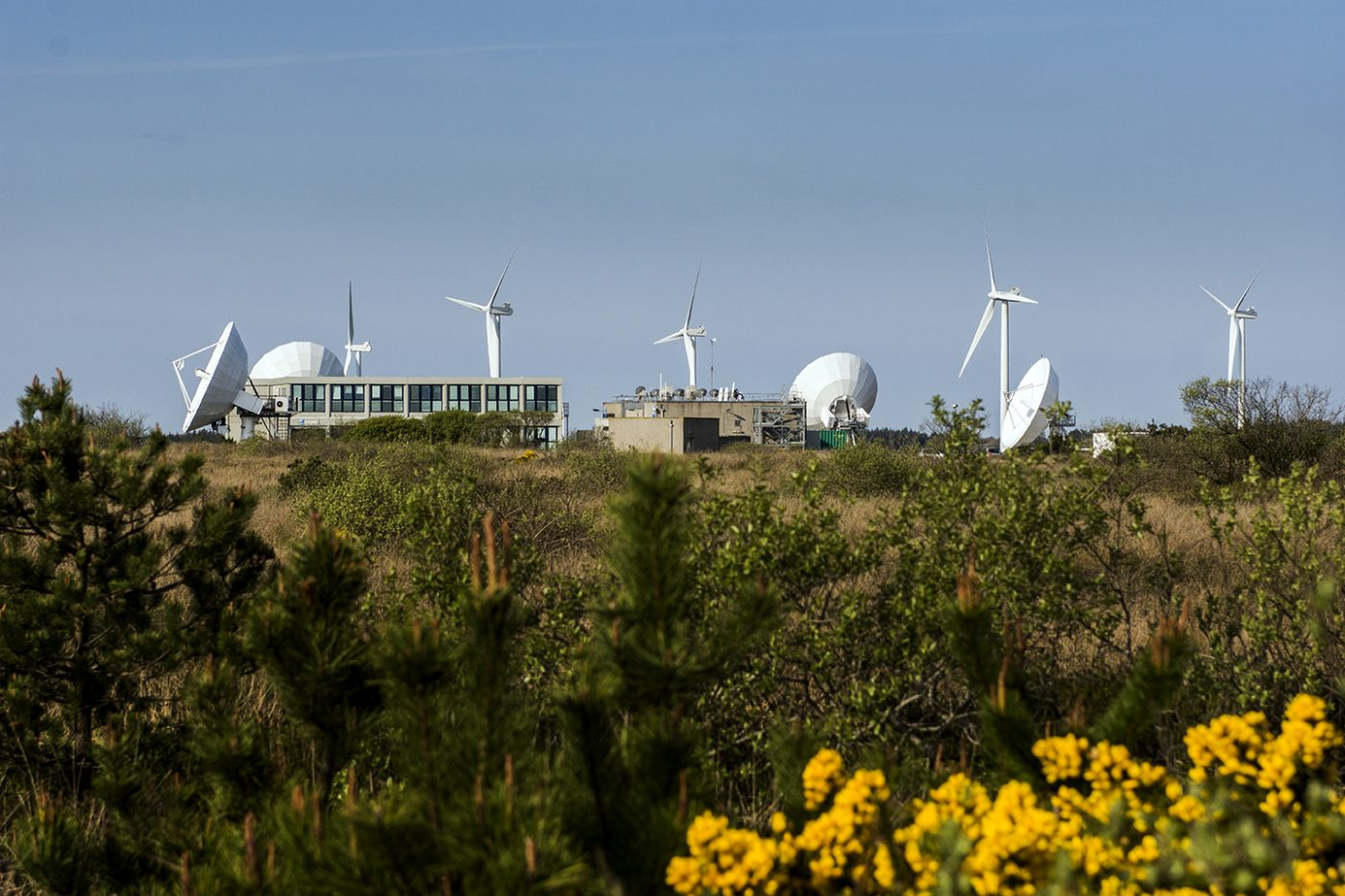 Satellites and wind turbines at Goonhilly Space Port, Cornwall.