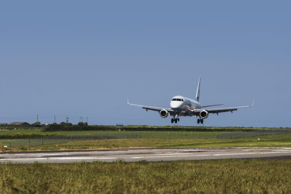 Airplane taking off from the runway at Cornwall Airport Newquay.